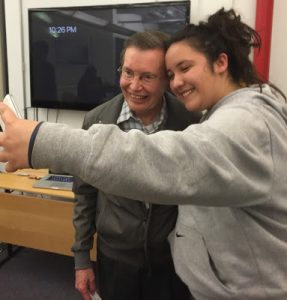 One of the storytellers Karolina Soto taking a selfie of herself with author Francisco Jimenez.